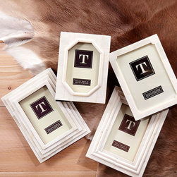 Hand Carved Photo Frames - Set of 4 - Ideal for a transitional space or any that require simple yet elegant accessories, the Provette Set of 4 Frames are a beautiful addition to every space. Gorgeous hand carved bone frames, each with detail all its own, will look stunning on your entry console or office shelf. Fill each with a treasured memory that will be preserved and protected with these luxe accessories that are fantastic alone or in a grouping.