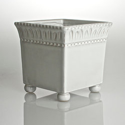 Charlot Cachepot Square - Small - Ceramic bun feet support the flaring cube of the Charlot Cachepot, a square planter for indoor and outdoor use made from ceramic glazed in a cool, creamy white.  Beaded rows edge the freehand texture details which band the cachepot's rim, perfectly combining the eloquence of tradition with the whimsy of artisan craftsmanship for an authentic look of the French countryside.
