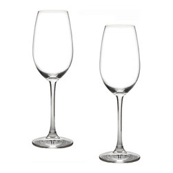 Riedel - Riedel Ouverture Champagne Glasses - Set of 2 - With this champagne flute, Riedel launches an outstanding, elegant and functional new shape. The slightly curved bowl delivers the full complexity and sometimes surprising concentration of a champagne's bouquet. On the palate, the glass emphasizes champagne's fine mousse and creamy texture, as well as highlighting its fruity character, harmony and balance. A tiny etched point at the bottom of the bowl guarantees a steady stream of fine bubbles.