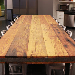 Reclaime Heart Pine Table Top - A 4' thick reclaimed heart pine table top sealed with Rubio Monocoat zero VOC wood sealer. When using reclaimed lumber there are many variables to work with like lumber from construction tear downs which will have nail holes, bolt holes, cracks and many other character marks. Reclaimed lumber can also come from river beads. This form of reclaimed wood looks like freshly cut lumber but can be 200-300 years old.