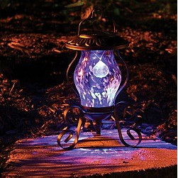 Solar Tabletop Reflector Lamp - I love this solar lantern. It's not only solar so you don't have to worry about candles or cords, it has a little reflector hanging in it that makes it different from other solar lamps. The glass is beautiful and it would look great on a table top outside.