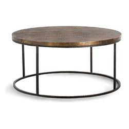 Nixon Coffee Table - A refined diamond-patterned texture scored into the wood top of the Nixon Coffee Table provides shape to its antique brass cladding, a directional look that contrasts with the more organic hammered texture on its cylindrical frame.  Geometry joins with the appeal of developing patina and metallic depth of color, making this a notable centerpiece to a seating area.