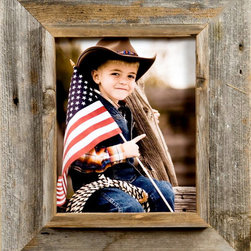 MyBarnwoodFrames - 20x24 Western Frame, Medium Width 3 inch Western Rustic Series - Western  Frame  for  the  Wild  West  Enthusiast          A  Western  Frame  can't  get  more  authentic  than  this.   Built  from  barnwood  we  reclaim  from  aging  outbuildings,  fences  and  barns  all  over  the  American  West,  these  handmade  rustic  frames  are  the  perfect  gift  for  the  cowboy  or  cowgirl.  They  also  make  great  wall  accessories  for  western-themed  rooms.                  Frame  is  crafted  from  authentic  barnwood              One  20x24  photo  opening              Final  product  approximately  26x30              Frame  width:   3              Flat  outer  frame  is  2-1/2  inches  wide,  interior  casing  for  the  frame  is  1/2-3/4  inches  wide              Depth  of  interior  shadowbox  is  approximately  1/2  inch.              Ships  without  glass.  Choose  add  plexiglas  if  desired              The  flat outer  edge  of  the  Western  Frame  is  2  1/2  inches  wide  with  a  1/2  inch  interior  casing,  making  the  entire  frame  width  just  over  3  inches  wide.   This  generous  frame  width  highlights  the  beautiful  textures  and  colors  of  the  natural  barnwood  without  overpowering  the  framed  subject.            Here  in  the  Rocky  Mountains  where  we  craft  these  rustic  wooden  frames,  we've  learned  to  appreciate  nature's  handiwork,  and  this  frame  was  designed  to  be  the  perfect  way  to  showcase  your  encounter  with  the  earth,  ocean  or  sky.  Our  western  frames  are  available  in  all  standard  sizes.   We  can  customize  a  frame  of  any  dimensions  if  you  can't  find  the  size  you're  looking  for  here.          Because  of  its  shadowbox  look,  this  western  frame  lends  itself  to  all  kinds  of  creativity.   Remove  the  backing,  frame  a  piece  of  antique  stained  glass  and  center  it  over  a  sunny  window.   Insert  a  colorful  mat  and  frame  