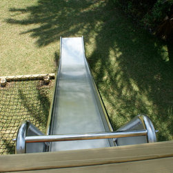 Stainless steel slide for treehouses - Our stunning stainless steel slide for treehouses by Treehouse Life.