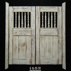 Custom Swinging Saloon Doors - Handcrafted swinging doors commissioned by a new Vancouver, Canada restaurant. I worked with them to develop a design they were pleased with using knotty pine and reclaimed antique spindles with a hand painted worn effect.