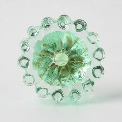 Violette Knob, Mint - I can see this knob used on a cabinet like this. It would look sweet and chic at the same time.