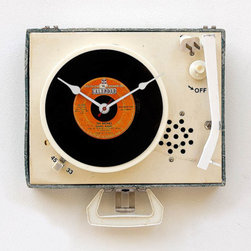 Record Player Clock by Stuff Made From Stuff - I lurve upcycled homewares and this would have to be one of the most ingenious examples I've ever seen. How funky would this look hung low beside a '60s lounge suite or in a family music/game room?