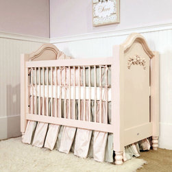 """Newport Cottages - Newport Cottages Cape Cod Roses Crib - Newport Cottages creates relaxing and happy nurseries and bedrooms with traditional, bench made furniture. Feminine and sweet, the Cape Cod crib lends warmth to a baby's nursery. Featuring hand-turned legs, dual level fixed gates and rose crescent appliques, this beautiful furnishing is finished with an optional under-crib storage drawer, adjusts to three mattress heights and converts to a toddler bed with the optional guardrail kit. Shown in pale pink, this crib is available in several finishes. Variance in color or texture is possible due to inherent qualities of handcrafted, hardwood furniture. Made in the USA and completed with non-toxic, low VOC finishes. Available with a standard or distressed finish. Distressing on stained finishes not recommended. 32""""W x 58""""D x 50""""H. Crib mattress not included. Mattress heights: 22"""", 18"""" and 14"""". Some assembly required*To further customize with additional finish and hardware options, please email shop@laylagrayce.com or call (877) 907-1322 for further details."""