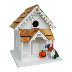 """Home Bazaar Inc - Season's Tweetings Birdhouse - The Season's Tweetings Birdhouse rings in all Four Holiday Seasons. This cottage style birdhouse comes equipped with four interchangeable, seasonal decorations; American Flag for Summer/4th of July, Jack-O-Lantern for Fall/Halloween, Christmas Tree for Winter/Christmas and, our favorite, a miniature Birdhouse to herald the arrival of Spring/Easter. This fully functional house has a 1.25"""" opening, removable back wall, drainage, ventilation and an unpainted interior. An attached mounting peg makes installation a snap. Constructed of exterior grade ply-board, Pine roof shingles and poly resin for detail and decorations."""