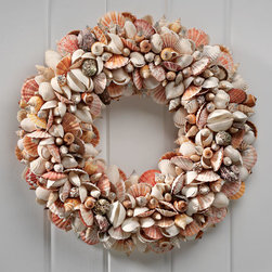"""Exposures - Nantucket Shell Wreath - Overview Celebrate the holidays in beach house style with this spectacular wreath. Shells are individually chosen and hand glued to create an upscale, Vineyard-inspired showpiece that looks great year-round.   Features Natural shells Wood frame Felt backing  Specifications  19 1/2"""" diameter x 3 1/2"""" high    Shipping  Please allow 2-3 weeks for delivery"""