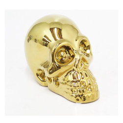 Yorick Gold Skull Bank - Bring out your poetic side with this ceramic skull bank. Made for desires and dreams, this guy will look after your savings. Alas, poor Yorick.