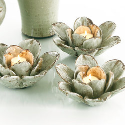 Lotus Blossom Voltive - Set of Three - Create a bed of roses or a meditative vignette of lotuses with the layered ceramic petals of these three detailed blooms. The Lotus Blossom Votives capture what all double-blooming flowers have in common: ruffled beauty, graceful delicacy, and exquisite visual harmony. Glazed in the coolest and softest of earthy grey-greens with deep brown antiquing at the petal edges, these candle holders receive a votive or tea light in the center of the naturalistic flower.