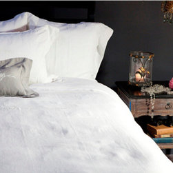 Classica Duvet Cover & Shams - A sophisticated line with ornate center embroidery in white yarn finished with a classic hemstitched 3 inch flange. This duvet features some elegant details on the top fold as well. Available embroidered or plain. Duvets and shams have hidden zipper closures. They are packaged without inserts which are available separately.
