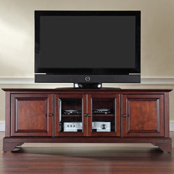 Crosley - Crosley LaFayette 60 in. Low Profile TV Stand - Vintage Mahogany Brown - KF10005 - Shop for Visual Centers and Stands from Hayneedle.com! The Crosley LaFayette 60 in. Low Profile TV Stand - Vintage Mahogany customizes your home decor style with its classic look. This entertainment cabinet is sized to complement today's larger homes and it holds most 60-inch flat panel TVs. It is made of hardwood and quality veneers with a hand rubbed multi-step vintage mahogany finish and antique brass hardware. Three adjustable shelves offer plenty of versatile storage while the cord management feature tames the unsightly mess of tangled wires. Two raised panel doors conceal stacks of DVDs games and media components while tempered glass doors protect electronic components from dust and allow remote control access. Versatile media storage!Additional Features:Accommodates up to a 60-inch flat panel TV3 adjustable shelves give 6 levels of protected storageDual tempered glass doors allow remote control access2 side cupboards with raised panel doors and 1 adjustable shelf eachCord management featureAbout Crosley FurnitureIn 1920 Powel Crosley founded the company that pioneered radio broadcasting and mass market manufacturing around the world starting with a simple radio meticulously crafted with obsessive detail and accuracy and a measure of consideration for the wallet. These high ideals have served the company well for over 90 years and they live on in the newest addition to the family. Crosley Furniture sets a new standard for innovation function and meticulous craftsmanship in the manufacture of value-priced furniture. They proudly offer durable furniture products featuring hardwood and veneer construction with rich multi-step finishes in a multitude of styles.