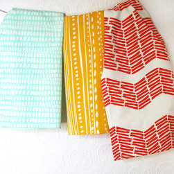 Dish Cloth Set of Three - When it comes time to clean up, use tea towels that are just as colorful as the rest of your decor. The hand-drawn illustrations on these would be the perfect addition to any modern abode. You could even wrap these up individually and gift them to party guests.