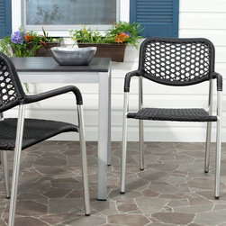 Safavieh - Safavieh Sitka Stackable Dining Chair - Set of 2 Multicolor - FOX5200A-SET2 - Shop for Chairs and Sofas from Hayneedle.com! Urban chic meets country living in the Safavieh Sitka Stackable Dining Chair - Set of 2. These simple outdoor dining chairs are loaded with style from the unique visual combination of metal and wicker to the comfortably breathable honeycomb weave on the seatback. The ultimate blend of fashion and function the Sitka stacking arm chair by Safavieh is crafted for stylish guest seating for indoor or outdoor entertaining. This set of two aluminum framed chairs is perfect for open-air bistro dining or for a casual conversation space.About SafaviehConsidered the authority on fine quality craftsmanship and style since their inception in 1914 Safavieh is most successful in the home furnishings industry thanks to their talent for combining high tech with high touch. For four generations the family behind the Safavieh brand has dedicated its talents and resources to providing uncompromising quality. They hold the durability beauty and artistry of their handmade rugs well-crafted furniture and decorative accents in the highest regard. That's why they focus their efforts on developing the highest quality products to suit the broadest range of budgets. Their mission is perpetuate the interior furnishings craft and lead with innovation while preserving centuries-old traditions in categories from antique reproductions to fashion-forward contemporary trends.