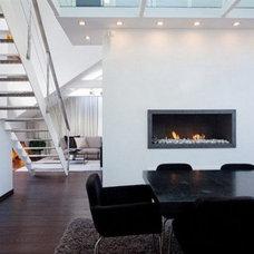 modern-loft-apartment-black-dining-table-and-metal-stair-design-10-533x355.jpg