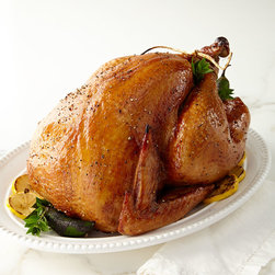 Horchow - Jalapeno Smoked Turkey - N/A - Jalapeno Smoked TurkeyDetailsPlump 10-12 lb. turkey injected with jalapeno flavoring then smoked over hickory chips for 8-10 hours.Ships fully cooked and frozen. Thaw in refrigerator overnight. Bake covered in preheated 325-degree oven for 60-75 minutes. Let stand for 10-15 minutes; slice and serve.Serves 12-15; approximately 3-4 ounces per serving.Made in the USA.Perishable items are shipped to you directly from our vendors. Therefore if you need to cancel an order we must receive the cancellation at least four days prior to your requested delivery date. We added all garnishes as inspiration for your own presentations.