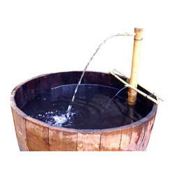"""Master Garden Products - Water Tight Shallow Wine Barrel Planter, 17""""h - We turn used wine barrels into half barrels, shallow barrels, three quarter barrels and the unique split barrel planters for your planting needs. Half barrels are perfect for standard size planting materials."""