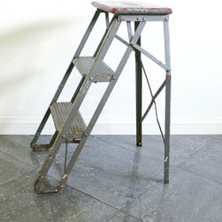Vintage Wood and Metal Step Ladder by Roberta Grove - Industrial style is all about rethinking how we use things. A vintage metal and wood ladder can also be a bedside library or a stand for baskets of towels and toiletries in the bathroom.