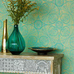 Yasmin - A stunning global chic look, gold and teal medallion wallpaper, hand-carved wood table that's finished with a modern style glass vase and antique gold platter.