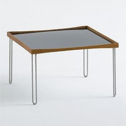 Tray Table - Designed in 1965, Finn Juhl's Tray Table has a reversible tabletop that you can flip over to reveal the color on the opposite side. Framed in solid walnut, the durable laminate top is glossy white on one side, glossy black on the other. Supporting the tray top are four simply shaped legs made of stainless steel. This original is an authentic, fully licensed product of Onecollection, House of Finn Juhl™. Made in Denmark. The reversible tabletop is glossy white on one side, glossy black on the other. The tabletop is framed in solid walnut. The square shape of this table makes it suitable for use in front of a sofa or between two chairs.