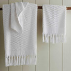 """Viva Terra - Ankara Hand Towel - White - Our extra-absorbent pesticide-freeTurkish cotton towels, have a lush double-sidedpile and a hand-tied fringe border.The matching shawl-collared robe hasfront patch pockets. BATH 36""""W x 65""""L, HAND 20""""W x 39""""L, WASHCLOTH 20""""SQ"""