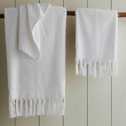 "Viva Terra - Ankara Hand Towel - White - Our extra-absorbent pesticide-freeTurkish cotton towels, have a lush double-sidedpile and a hand-tied fringe border.The matching shawl-collared robe hasfront patch pockets. BATH 36""W x 65""L, HAND 20""W x 39""L, WASHCLOTH 20""SQ"