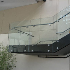 Modern Staircase by ATM Mirror and Glass