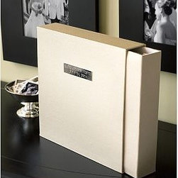 """Engravable Wedding Album with Optional Personalization - Encased by luminous, champagne-tone grosgrain fabric, our elegant photo album and matching storage box keep special memories organized and protected. 13"""" square Makes a perfect gift for the bride and groom. Includes an engravable silver plaque and 45 double-sided adhesive page inserts. Simple mechanism allows pages to be inserted and removed easily. Plaque may be engraved with up to 2 lines of 18 characters each for an additional fee. Catalog / Internet Only."""