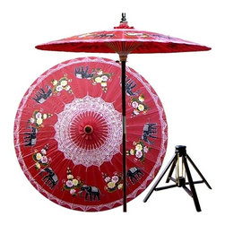 Oriental Unlimted - Asian Elephants Patio Umbrella in Dragon Red - Includes Bamboo stand. Handcrafted and hand-painted by master artisans. 100% Waterproof and extremely durable. Umbrella shade can be set at 2 different heights, 1 for maximum shade coverage and the other for a better view of the shade. An optional base, which secures the umbrella rod and shade against strong winds and rain. Patio umbrella rod and base is constructed of stained oak hardwood for a rich look and durable design. Umbrella shade is made of oil-treated cotton. Minimal assembly required. Canopy: 76 in. D x 84 in. HThis magnificent patio umbrella highlights a circle of Asian elephants, which symbolize strength, power and wisdom. Lovingly hand-made in Thailand, where the elephant is the national symbol, this umbrella is the perfect way to enhance any outdoor area.