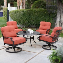 Belham Living Palazetto San Miguel Cast Aluminum Chat Set- Seats 4 - The Palazetto San Miguel Cast Aluminum Chat Set- Seats 4 is an easy and attractive way to convert your patio, deck or outdoor space into a fun and carefree conversation Mecca. This handsome set includes four durable cast aluminum rocker chairs with full 360-degree swivels. Each chair is fitted with comfortable solution-dyed olefin cushions, which withstand weather better than traditional polyester, and keep your patio set looking brand new for multiple seasons. The 42-inch round chat table is constructed from complimenting cast aluminum and furthers the classic scrollwork motif. The traditional design effortlessly brings a classic taste to any space, while the radical juxtaposition of the bright cushions dashes modern style into the mix. Additional Information: Chair Dimensions: 33.5L x 29.25W x 34H inches Table Dimesions: 42L x 42W x 21H inches About Alfresco HomeOffering a wide selection of fashionable products, from casual furniture and garden lighting to permanent botanicals and seasonal decor, Alfresco Home casual living products offer a complete line of interior and exterior living furnishings and accents. Based out of King of Prussia, Penn., Alfresco Home continues to blend indoor and outdoor furniture to make a lifestyle of alfresco living inside and outside of the home. Inlaid mosaic tabletops, fine hardwood furnishings, artisan-inspired accents, premium silk botanicals, and all-weather wicker sets are just a few examples of the kind of treasures you'll find in Alfresco's specially designed collections.