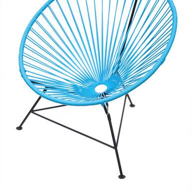 Innit Chair - Blue - This circular lounger harmonizes the function of ergonomic comfort with a retro-modern aesthetic. The flexible yet durable vinyl cord weave perfectly cradles your body within its clean lines and offers a casual sophistication to every home.