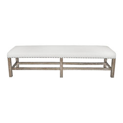 Kathy Kuo Home - Aquitaine Grey Wash Wood French Country Bench - Our extra-long bench has clean lines and a relaxed elegance that makes a smart addition to your French country settings. Topped with a white cotton cushion with nail head trim accents, the solid mahogany frame has a soft grey wash so it blends effortlessly with other wood finishes in the room. A stunning chaise banquette for dining or for window-side daydreaming.