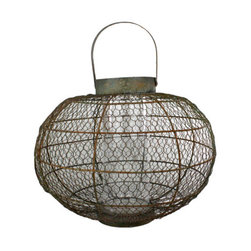 Globe Party Lantern - Medium - Light your deck, patio, garden, or any room in your home with Globe Party Lanterns. With a faux rust finish accented with paint for depth, these lanterns adapt perfectly to many styles of decor-Asian, rustic, beach, farmhouse, to name a few. Inner hurricanes protect the soft candlelight from the wind, to ensure that wherever they are placed, Globe Party Lanterns will provide light, atmosphere, and style. This lanterns are available in two sizes, 19 x 14 with 5.5-inch drop handle (use with a 3x6 pillar candle), and 26 x 19 with 8-inch drop handle (use with a 4x6 pillar candle).