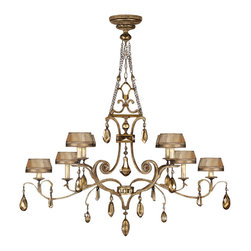 Fine Art Lamps - Golden Aura Chandelier, 755440ST - Dripping with glorious gold-hued crystals, this distinctive chandelier is the perfect way to accent and illuminate your favorite formal space. Note how the warm patina finish and hand-sewn shades of silken taupe create a unified message of color.
