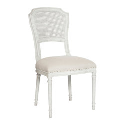 Kathy Kuo Home - Pair Camilla French Country White Wash Shabby Chic Dining Chair - In the language of classic French country decor, the cane back upholstered chair is one of the most eloquent and popular ways to achieve that essential balance between formal and relaxed style.  Upholstered in a light white linen and gently distressed, this pair are two of our most comfortable dining chairs and make a lovely couple whether placed at a table or as additional seating in the living room.
