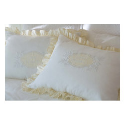 Taylor Linens - Good Night Cream & White Linen Standard Sham - You can wake up and go to bed every day on the right side of the bed with one of these sweet pillow shams. It's made from buttercream and white linen and features a frilly ruffle and a finely embroidered center shield with flowers and a cheerful message. A good morning or night is practically guaranteed.