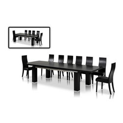 "VIG Furniture - Maxi 78""-126"" High Gloss Black Extendable Dining Table - The Maxi dining table is a great addition for any dining room looking to add a modern touch to it's decor. This dining table is crafted from solid wood products making it a very durable table. The table comes with a standard size of 87"" for smaller gatherings and extends up to 126"" making it perfect for larger gatherings. The table comes in a high gloss black finish with a very modern square design that adds to the overall look. The price shown includes the table only."
