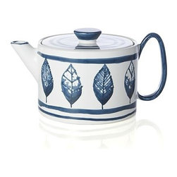 Tulah Teapot - Our limited-edition earthenware tea set features the inventive artistry of an Italian husband/wife team who create intriguing handcrafted pieces reminiscent of traditional porcelain with more than a touch of the unconventional. Square-off teapot loops an extravagant handle, accented with whimsical, hand-painted stripes and leaf motifs in blue on off-white.