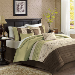 Madison Park - Madison Park Serene 7 Piece Comforter Set - The Serene Bedding Collection provides an elegant look to your home. The top of the comforter is a mix of green, chocolate brown, and taupe with piecing details while the taupe section has an embroidered floral pattern for a soft divide from these bold colors. Made from polyester dupioni, this fabric will produce a shine and pick up the light on both the comforter and shams. The decorative pillows come in a combination of solids, stripes, and embroidery to pull this whole set together. Comforter/Sham: 100% polyester polyoni, pieced, solid polyester reverse, 8oz/yd2 polyester filling Bedskirt: 100% polyester polyoni, polyester platform Decorative Pillow:polyoni cover and polyester filling