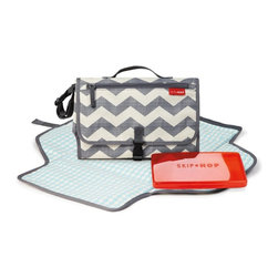 Skip Hop - Skip Hop Pronto! Changing Station - Chevron Multicolor - 202204 - Shop for Diaper and Bottle Bags from Hayneedle.com! Ideal for quick errands walks or for leaving in the car so you're never caught without diapers and wipes the Skip Hop Pronto Chevron Changing Station carries all the essentials. The Skip Hop Pronto has a front zippered pocket which keeps your phone wallet and keys secure while the mesh pocket is able to hold up to four large diapers creams and more! The included wipes case is translucent so you can always see if you're about to run out of wipes. An extra wide changing pad is ideal for wiggly babies has a cushioned pillow for your baby's comfort and zips off completely for independent use. Without the changing pad the Skip Hop Pronto becomes an independent diaper carry-all. The strap is perfect for hanging on your wrist or shoulder so you always have just what you need close at hand. Additional Features Changing pad zips off for independent use Head cushion keeps baby safe and comfortable Easy-to-clean wipe clean surface About Skip HopThe ultimate goal of Skip Hop is to develop products that make parenting better. Skip Hop is a New York City company devoted to the design of groundbreaking products to suit a new generation of parents. At Skip Hop they truly understand today's moms and dads because that's who they are. They're in tune with the cool person you were before parenthood and know that you're even cooler now that you're a mom or dad. Skip Hop gets it. They strive to create products that are smarter more innovative and safer. These are products that appeal not only to your heart but to your modern sense of design. A percentage of each Skip Hop product sold is given to support various organizations such as the Pediatric Aids Foundation and The Ovarian Cancer Research Fund.