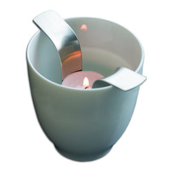 Mono - Wing Windlight Set - Suspend your winged tea light candleholder in a porcelain mug, and behold a cozy portable glow!  Soothing baths, outdoor garden parties or illumination for cold winter nights — this candleholder has wings and legs!