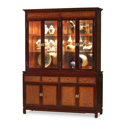 "China Furniture and Arts - Rosewood Flower and Bird Motif China Cabinet - A grand curio cabinet to display your treasured collectibles. A hand-carved flower and bird motif decorates the upper panels, lower doors, and drawers. Made of solid rosewood with traditional joinery techniques by artisans in China. In the upper interior, mirrored glass, halogen lights, and adjustable shelves allow the presentation of your treasured collectibles. The bottom cabinet has two double doors with removable shelves inside and four drawers providing ample storage space for your convenience. Hand applied classic natural finishes with mahogany trim rounds out its quiet beauty. The doors all feature brass door pulls. The total top interior space measures 56""W x 15""D x 39""H, and the bottom compartment measures 58.25""W x 17""D x 18""H."