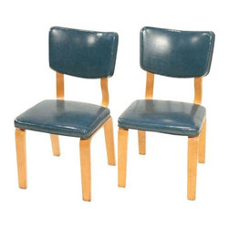 "Thonet - Pre-owned Mid-Century Bentwood Chairs by Thonet - If you want to give your home a fun, retro feel, this pair of Mid-Century Modern bentwood chairs would be a great way to do so. They were manufactured by Thonet and boast studded back accenting as well as a rich, high quality blue naugahyde upholstery. We envision them in the dining room or living room flanking a console table. Chairs show age appropriate wear.    There is a matching long chest with a mirror, a tall chest, and pair of nightstands available, all listed separately.     The seat measures 17"" H."