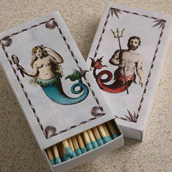 Mermaid / Neptune Matches - It is all in the details. Candle lovers delight with these artful and useful candle lighting accessories. Made for those who require the perfect finishing touches to their d�cor. The Mermaid / Neptune Matches have a delightful print on the box and are great for giving or keeping for ones self to ignite candles and set the mood.