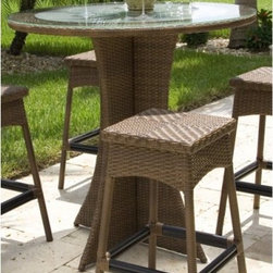 "Hospitality Rattan Grenada 42 in. Patio Bar Height Pub Table - Viro Antique Brow - With classic materials and a modern shape, the Hospitality Rattan Grenada 42 in. Patio Bar Height Pub Table - Viro Antique Brown with Tempered Frosted Glass goes from garden party to gastropub with ease. The Grenada Collection has a modern, tropical feel that offers a clean look for any patio area - not to mention the convenience of all-weather wicker. Supported by an aluminum frame wrapped in high quality Viro fiber, this all-weather round bar-height table has a decorative woven, four-sided pedestal-style base. The tempered frosted glass tabletop simply wipes clean, and the neutral antique brown finish melds with virtually any patio decor. Seats up to four people.About Hospitality Rattan Hospitality Rattan has been a leading manufacturer and distributor of contract quality rattan, wicker, and bamboo furnishings since 2000. The company's product lines have become dominant in the Casual Rattan, Wicker, and Outdoor Markets because of their quality construction, variety, and attractive design. Designed for buyers who appreciate upscale furniture with a tropical feel, Hospitality Rattan offers a range of indoor and outdoor collections featuring all-aluminum frames woven with Viro or Rehau synthetic wicker fiber that will not fade or crack when subjected to the elements. Hospitality Rattan furniture is manufactured to hospitality specifications and quality standards, which exceed the standards for residential use. Hospitality Rattan's Environmental Commitment Hospitality Rattan is continually looking for ways to limit their impact on the environment and is always trying to use the most environmentally friendly manufacturing techniques and materials possible. The company manufactures the highest quality furniture following sound and responsible environmental policies, with minimal impact on natural resources. Hospitality Rattan is also committed to achieving environmental best practices throughout its activity whenever this is practical and takes responsibility for the development and implementation of environmental best practices throughout all operations. Hospitality Rattan maintains a policy of continuous environmental improvement and therefore is a continuing work in progress. Hospitality Rattan's Environmentally Friendly Manufacturing Process All of Hospitality Rattan products are green. From its basic raw materials of rattan poles, peels, leather, bamboo, abaca, lampacanay, wood, leather strips, and boards, down to other materials like nails, staples, water-based adhesives, finishes, stains, glazes and packing materials, all have minimum impact to the environment and are safe, biodegradable, recycled, and mostly recyclable. Aside from this, the products have undergone an environmentally-friendly process that makes them """"greener."""" The company's rattan components are sourced from sustained-yield managed forests, which means the methods used to grow and harvest the rattan vines ensure the long-term life of the forest and protect the biodiversity of the forest's ecosystems. Hospitality Rattan is committed to buying and using all materials, from rattan and hardwood to finishing materials, from reputable and renewable suppliers and seeks appropriate evidence that suppliers are in compliance with this policy. Hospitality Rattan strives to use materials that are processed in an environmentally responsible manner, or consist of a high level of recycled material. Finishing materials and stains used in Hospitality Rattan's furniture products consist of 75% water-based solutions which evaporate upon application with reduced or Volatile Organic Compounds (VOCs). The furniture factories use water-based glues, stains, topcoats and other finishes on all of their products. The switch from traditional solvent-based processes to water-based processes involved consolidating several processes by the factories, resulting in an 85% reduction in VOC emissions."