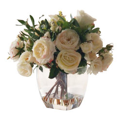"Winward - Rose In Glass Flower Arrangement - These fluffy cabbage roses have so much loving, lifelike detail, no one will ever guess they are silk! Luscious and creamy with subtle kisses of pink, they include various stages of bloom from bud to full flower, and their thorny stems extend into faux ""water"" for a final touch. Classic and neutral in their clear glass vase, they'll look gorgeous anywhere; you'll want them in every room of the house."
