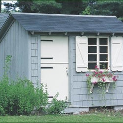 8' x 10' Storage Building - Dutch door with decorative hinge straps, spring lock and thumb latch. Double casement windows with operators. The shutters are hinged to close. There's a window box and brackets. It features cedar shingle siding, front only, and board and batten siding on the other three sides. Details include a window screen, and door step. Special body color. Trim is Navajo White.