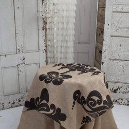 Couture Dreams Enchantique Natural/Bark Table Topper - Couture Dreams Enchantique Jute Table Toppers are what we like to call a French inspired Art Deco with a Modern Twist. Truly beautiful and unique these rustic chic jute table toppers are each hand printed with a large decorative motif. Offered in three different colorways, these table linens are sure to dress up any table. These table linens can be combined with any type of home decor from modern to traditional. They are made from fine, premium quality 100% all natural jute fabric which puts a fun and funky spin on traditional table linens.